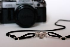 {realistic Camera Necklace} love the way she designed the necklace to look like a camera strap!