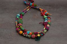 Mishmash 2, ethnic statement fiber art necklace, hand wrapped with felt, wooden, textile and acrylic beads. Colorful: red, blue, orange, yellow,