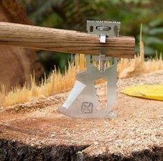 KLAX - The multi-function axe head of the KLAX is designed to clamp onto all types of handles—even one you fashion yourself from a tree limb; making it easier to pack and transport. Other built-ins include 5 wrenches, hex bit driver, bottle opener, hammer, & ruler. | Werd