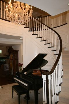 Spiral staircase, chandelier, baby grand piano! So cool!