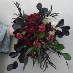 Burgundy wedding bouquet with foliage   Perfect #bridalbouquet photo by @woodstockflorist • in Wellington, New Zealand.