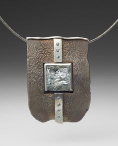 Neckpiece 4.  Roger Rimel. Sterling silver, shibuichi, fine silver, cleave cut aquamarine, aquamarines.