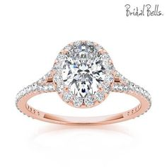 14K Rose Gold 2cttw Oval Shaped Halo Diamond Engagement Ring with Split Shank. Features 1/2cttw of prong set round G/SI side diamonds accenting a large 1.5ct oval center diamond. The diamonds form an