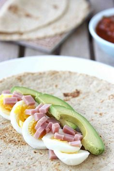 Egg Wrap Recipe with Ham, Avocado & Salsa - I didn't use salsa, but instead, I mixed a tablespoon of Miracle Whip Light with a very small amount of the dry Ranch Dressing mix and spread it on my Light Flat Out wrap.