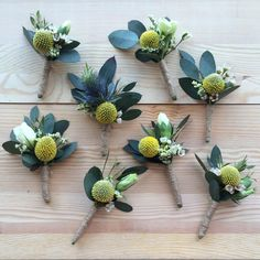 Rustic boutonnières for the groomsmen made with bright yellow craspedia billy balls.