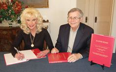 Photo courtesy of Highgate Publishing Dana and Bob Samuelson sign copies of their true tale of intrigue, murder and shady courtroom dealings...