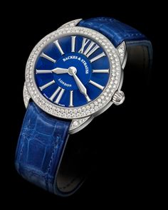 Backes & Strauss Piccadilly Renaissance watch in white gold, set with two rows of ideal-cut diamonds and finished with a blue alligator leather strap.