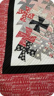 lil twister quilt, red, white and black, how pretty.