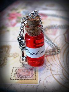 Alice in Wonderland Drink Me glass bottle necklace on eBay
