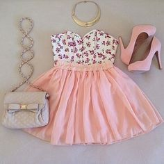 Floral sleeveless crop, pink circle skirt, pink pumps, gray over the shoulder handbag, and golden necklace.