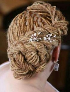 Formal locs hairstyle with hair jewelry