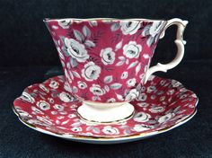 I don't know when the pattern was made, but I know that it's been discontinued. The base color of the bone china is white and the trim is in gold. The pattern features white and gray roses and leaves on a light maroon/pink background and is very attractive. | eBay!