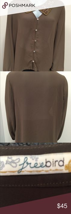Freebies Sheer Brown With Sequin Collar This unique sheer top is sure to turn heads with a unique cut out that creates a V-neck connected by a sparkly sequin bronze collar. This conventional button up top is preowned but practically new. From a smoke free and pet free home. There is a light stain (please see picture). The fabric content tag has been cut out. Tops Blouses