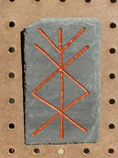 Bindrune for prosperity. Reclaimed roofing slate, hand carved and painted with cold pressed Red Ocher oil paint.