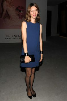 Sofia Coppola in a navy mini dress and flats.