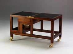 A George III design Mahogany four step metamorphic library coffee table, with decorative gilt incised leather top and leather steps opening to form library steps on square brass castors