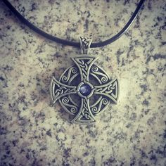 Solstice Solar Cross Necklace.