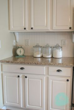 Love the beadboard backsplash and the wooden shelf brackets. It makes the cabinets look like a piece of furniture!
