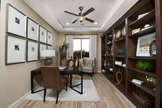 Beautiful bookcase & tray ceiling | Cassandra model home study | Tucson, Arizona | Richmond American Homes Richmond American Homes, Solid Wood Desk, Tucson Arizona, Home Office Design, Model Homes, Dream Homes, Home Buying, Offices, Bookcase