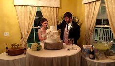Wedding couple cutting the cake at a Victorian mansion in Houston.