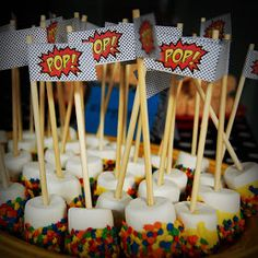 The Event Company: Superhero Birthday Party. Marshmellows dipped in white chocolate and fruity pebbles