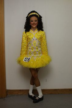 This dress and the wig colour are just so eye-catching! #Irish #Dance #Swarovski