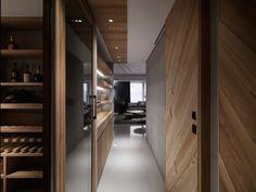 Jade Apartment / Ryan Lai Architects - Detalle de luz en mueble con tablillas, respaldar de camas