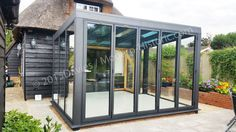 Modern glass room against the grade 2 listed building
