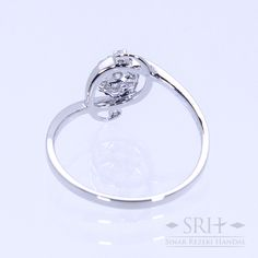 28295 18Karat White Gold Weight 1.60gr Ring Size 12.50 0.123 Total Carat = 8 Rounds Diamond 0.036 Total Carat = 1 Rounds Diamond