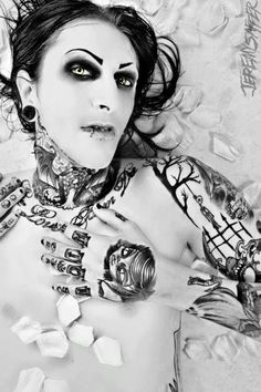 Chris Motionless. damn dude, have you ever seen with actual eyebrows...its weird