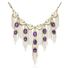 14K yellow gold Georgian fringe necklace comprised of natural seed pearl and amethyst fringe suspended from six woven seed pearl balls and crescent-shaped gold plaques, with cannetille-style links. European Circa 1830