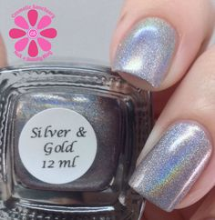 Colors By Llarowe Silver and Gold Swatch - Cosmetic Sanctuary; Brand: Colors By Llarowe, Name: Silver and Gold, Collection: Winter 2013, Color: Silver, Shade: Bright, Finish: Crème, Type: Linear Holographic