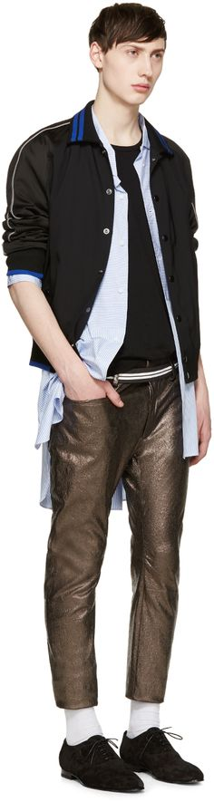Haider Ackermann Silver Leather Pants Hide details Skinny-fit leather pants in iridescent silver-tone. Textured throughout. Five-pocket styling. Raw edge at ankle cuffs. Zip-fly. Partially lined. Tonal stitching. 100% leather. Made in Portugal. Haider Ackermann Black Silk T-Shirt Short sleeve silk jersey t-shirt in black. Raw edges and slub texture throughout. Crewneck collar. Tonal stitching.