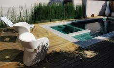 This cozy outdoor oasis by Richmond, Australia-based Eckersley Garden Architecture proves that good things really do come in small packages. Ideal for an urban environment where space is at a premium, this compact modern pool design layers urban and organic elements for an eclectic, original look.