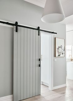Unlike a standard hinged door that requires floor space to swing open, a sliding barn door takes up little more space than the thickness of the door. door ideas 17 design ideas for small hallways Diy Barn Door, Sliding Barn Door Hardware, Bathroom Barn Door, Sliding Door Design, Sliding Bedroom Doors, Closet Doors, Sliding Door For Bathroom, Indoor Sliding Doors, Indoor Barn Doors