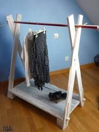 pallet made into clothing cart? It would only need to add some wheels