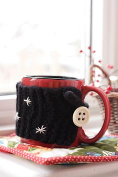 Mug Cozy DiY - This is knitted, but I could convert to crochet :).