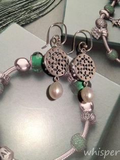 Pandora pearl earrings.