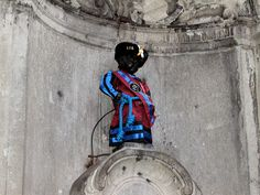 Manneken Pis - Brussels...Another legend says that a man had lost his little son. He found the child after two days near the place where now the fountain of manneken-pis can be seen. When the father spotted his child, the latter was peeing. As a token of gratitude the father had the fountain with a statue of a peeing boy constructed.