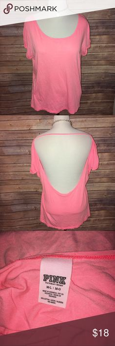 VS PINK Bright Pink/Coral Low Back Tee Awesome bright shade of coral/pink. Nice and soft and loose. Size M/L fits oversized. Excellent condition, no flaws. Check out my other listings to bundle and save 25% 😎! PINK Victoria's Secret Tops Tees - Short Sleeve