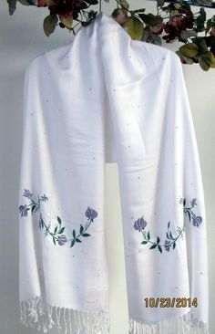 White shawls on sale buy ladies shawls in all colors from white to pastels for spring and summer shawls. Fall and winter darker colored shawls are wonderful seasonal and instyle. http://www.yourselegantly.com/bridal-bridesmaids-shawls/wedding-shawls.html