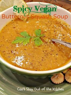 Spicy Vegan Butternut Squash Soup: 2-3 lb. butternut squash,  1 onion,  1 garlic bulb, roasted,  2 tbs coconut oil,  2 tbs fresh ginger,  2 tsp ground coriander,  ¾ - 1 tsp ground cumin,  ¾ - 1 tsp turmeric,  2 tsp. ground cinnamon,  ⅛ tsp. red chili flakes,  32-oz. vegetable stock,  ½ teaspoon salt,  juice of half a lime,  black pepper,  1 cup coconut milk,  Cracked black pepper, parsley, cayenne pepper, and oyster crackers for garnish