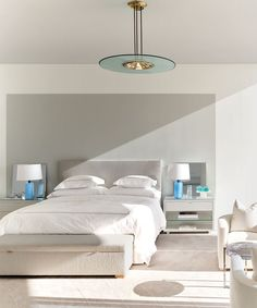 In this poppy Miami Beach home designed by Lee Mindel, the headboard, in a Chapas Textiles fabric, Atelier Prelati nightstands, and bench are all custom. The vintage Max Ingrand pendant is by FontanaArte #miamibeach #beachhome #modernhome