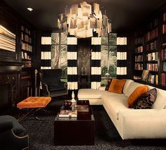 Library - sophisticated sectional, dark walls, horizontal stripe cream and black curtains, nail head trim, tufting, soft cozy textures - http://www.nbdesigngroup.net