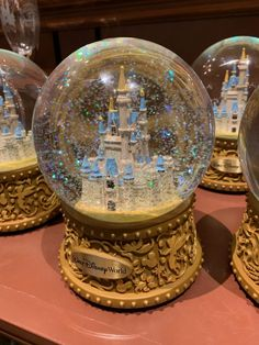 Share This!When you think about classic souvenirs, one of the first things that might pop into your mind is a 3d Globe, Disney Snowglobes, Glitter Globes, Disney Souvenirs, Christmas Party Themes, Disney On Ice, Christmas Snow Globes, Disney Figurines, First Snow