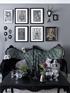 Really cool living room inspiration! Love the pictures on the wall, the sofa and the decor on the table.