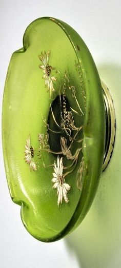 Émile Gallé, Nancy 'Un peu, beaucoup, passionément' bowl with silver mounting, c. 1890 'Verrerie parlante'. H. 6.7 cm, D. 23.7 cm. Overlaid glass, colourless and green. Etched and polychrome enamelled decoration with daisies and the counting rhyme: Un Peu Beaucoup Passionnément; heightened with gold. Signed: Déposé Gallé Nancy (gold heightened). Silver mounting stamped: Minerva's head. Bowl, Decorative Plates, Decoration, Home Decor, Decor, Decoration Home, Room Decor, Decorations, Decorating