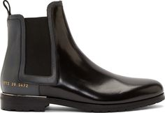 Buffed leather chelsea boots in black and grey. Round toe. Inset side and collar panels. Pull-tab at heel collar. Elasticised panels at sides. Signature series stamp at outer heel in gold. Metal trim in silver-tone at heel. Rubber sole. Tonal stitching.<br><br>Part of the Robert Geller x Common Projects collaboration.<br><br>