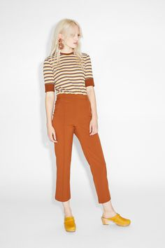 These on-trend high-waisted slacks hit just above the ankle, and feature dueling seams down the front.