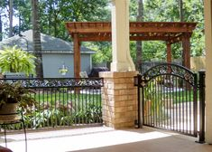 brick pillar and wrought iron for back patio